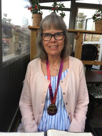 Maria på Porter Pella med medalje